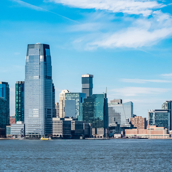 New Jersey city skyline seen past a large blue body of water