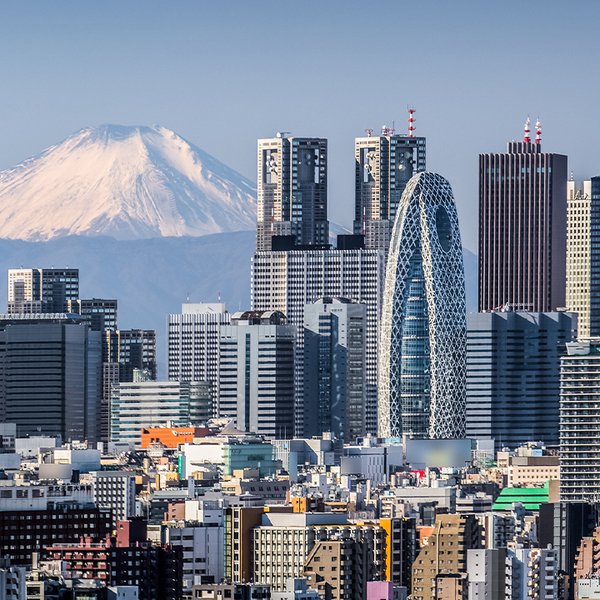 High building at Tokyo shinjuku and Mt. Fuji with snowy mountain in the background