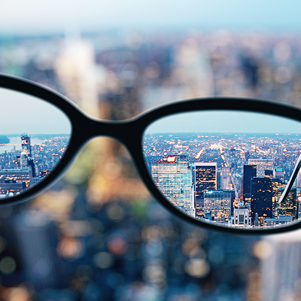 Close up of glasses on blurry city background. Clean vision concept. 3D Rendering