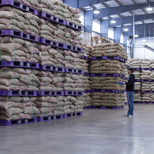 Bags of coffee in a warehouse