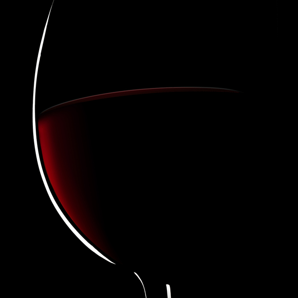 Glass of red wine against a dark background