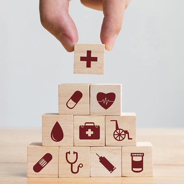 Wooden toy block pyramid with healthcare symbols on each block