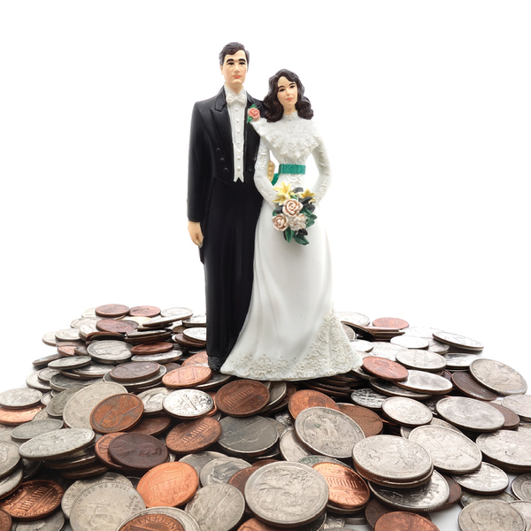 Plastic figures of a married couple, with a pile of coins behind them