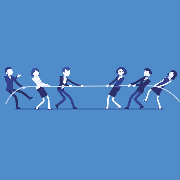 Business men and women playing tug of war