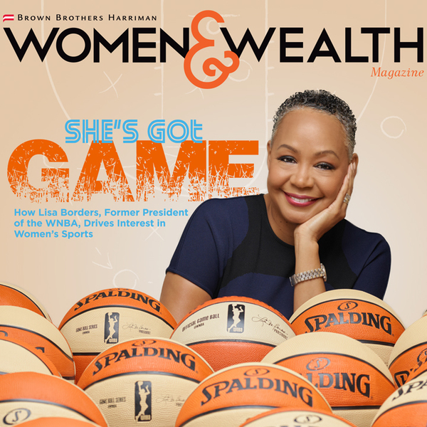 Lisa Borders surrounded by orange basketballs