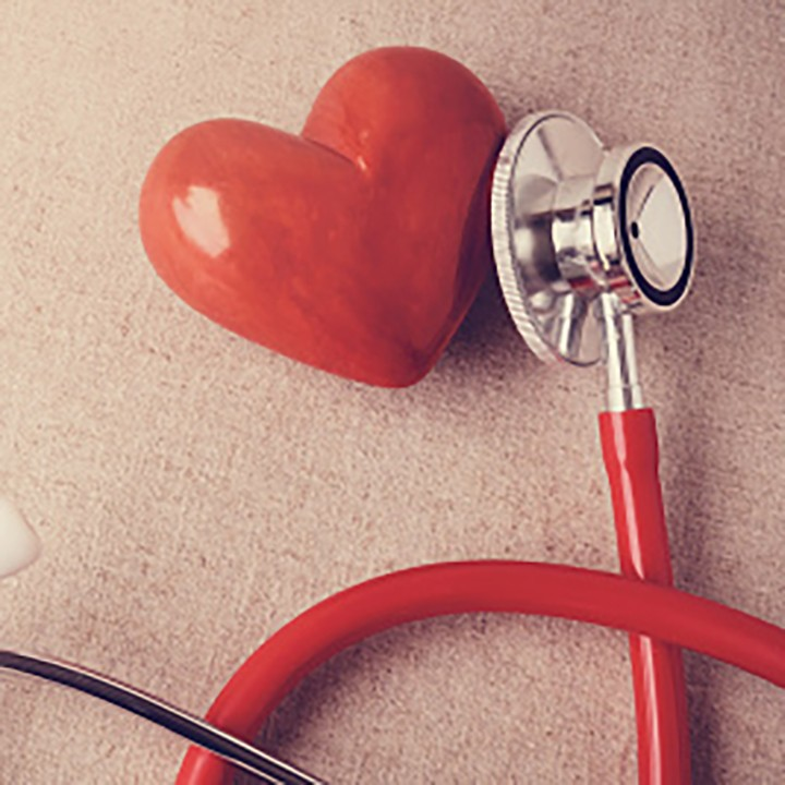 A red heart next to a stethoscope