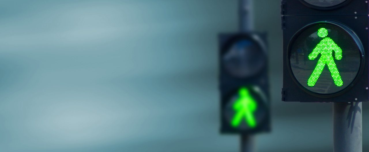 Traffic light with a green walk symbol