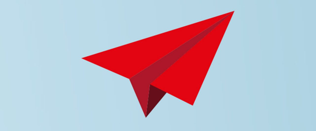 Red Paper airplane in the sky