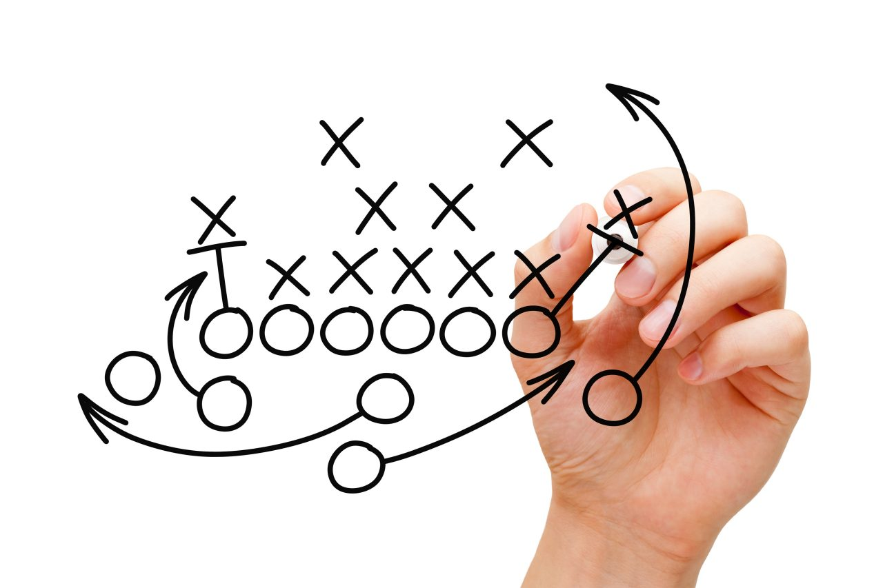 Hand drawing American football strategy with black marker