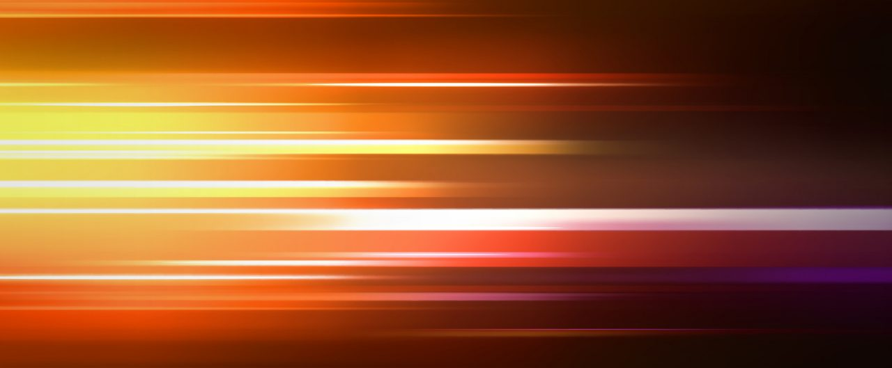 Pattern of gold and red tones streaking across the background