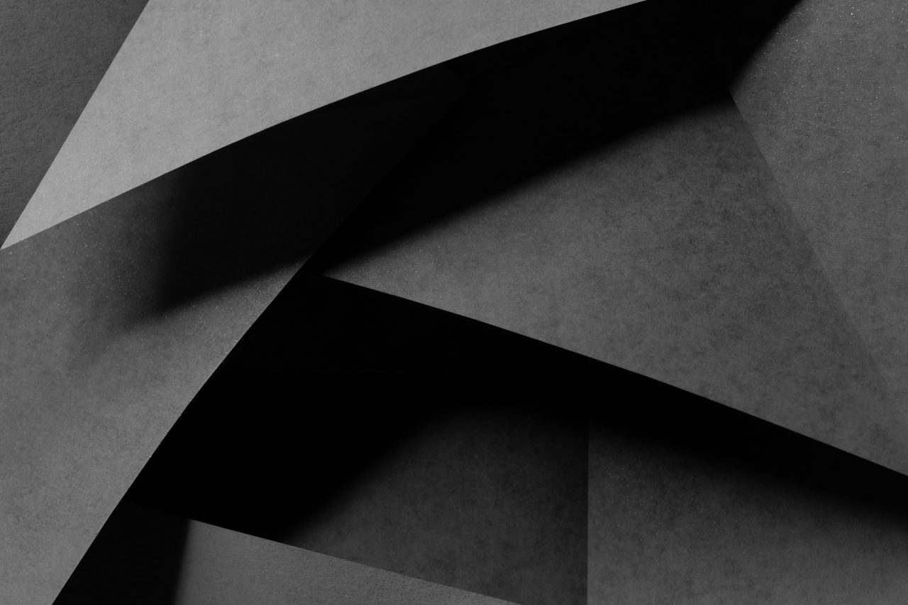 Geometric shapes made of gray paper